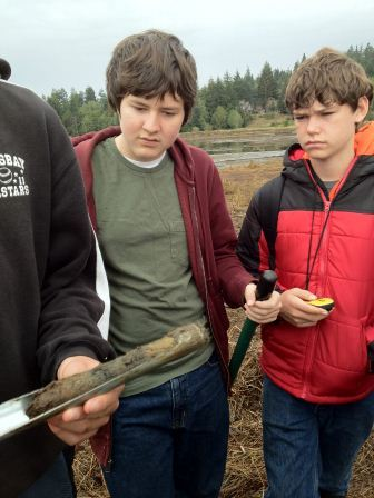 Students view soil sample